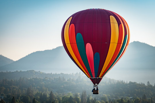 Colorful hot air balloon over Grants Pass Oregon on a beautiful summer morning