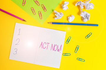 Word writing text Act Now. Business photo showcasing fulfil the function or serve the purpose of Take action Do something Blank squared notebook pencils paper sheet crushed balls colored background