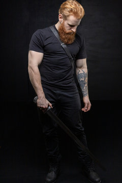 Red-haired urban fantasy man with tattoos
