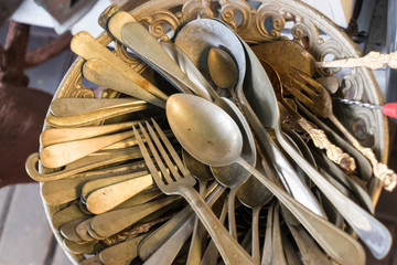 Old metal spoons and forks