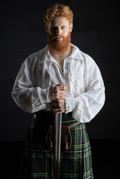 Historical, Red-haired Scotsman with a sword