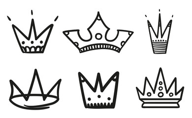 Monochrome crowns on isolated white. Hand drawn simple objects. Line art. Black and white illustration