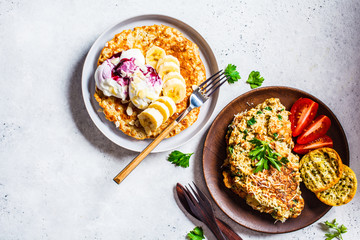 Oatmeal omelet with cheese and sweet oatmeal pancake, top view. Healthy breakfast concept.