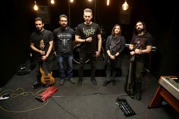 "Iranian members of a Progressive/Djent band named ""Atria"" pose for a photo at a voice studio in an art department in Tehran"