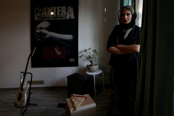 Iranian woman singer Hanieh Kian poses for a photo in her home in Tehran