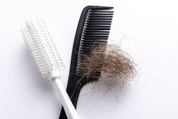 Comb and hairbrush with lost hair
