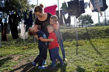 Katarzyna Ichnowska poses with her children in Nowa Karczma