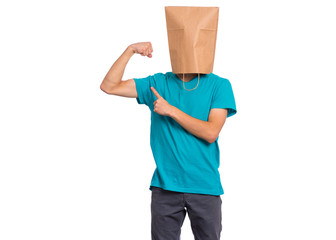 Fototapete - Portrait of teen boy with paper bag over head raised his hands and shows biceps, isolated on white background. Child shows biceps.