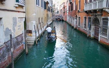 Foto op Canvas Gondolas Undefined gondolier operate gondola through the narrow canal of Venice. Italy