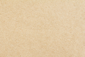 Brown beige sheet of craft cardboard paper texture background.