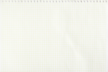Closeup white checkered notebook sheet of paper texture background. Horizontal image.