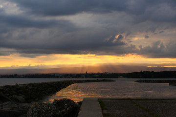 Sunbeams during sunset at the Lake Geneva. Location: Vidy, Lausanne, Switzerland.