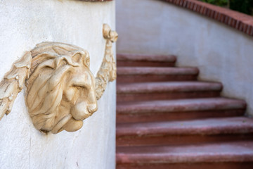 Lion head statue at the enter of a luxury home.