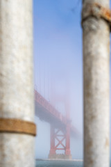View of the Golden Gate Bridge in the fog.