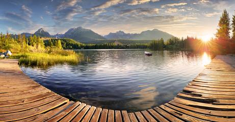 Panorama of Mountain lake Strbske pleso in National Park High Tatra, Slovakia, Europe at sunrise