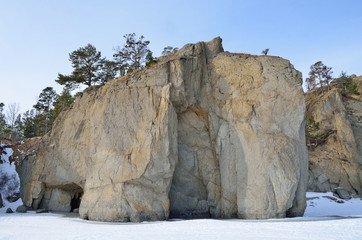 Rock formations on the shore of Peschanaya (Sandy) Bay, lake Baikal. Russia, Siberia