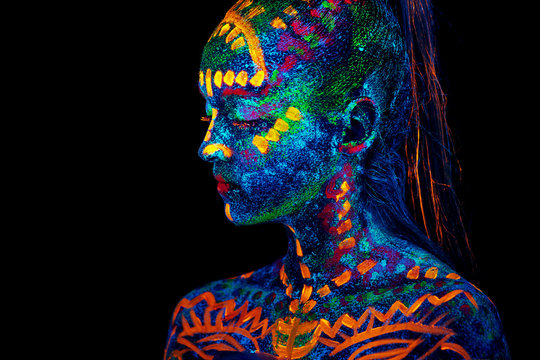 UV body art painting of helloween female african warrior