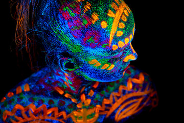 UV body art painting of helloween female african warrior