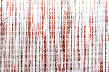 Abstract decorative background with wicker surface texture horizontal in a vertical curved strip of...