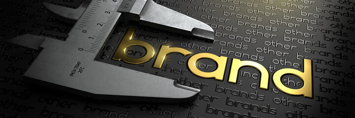 Obraz Business Concept with Golden Word BRAND on Black Background and Vernier Caliper. - fototapety do salonu