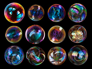Group of soap bubbles isolated on black background.