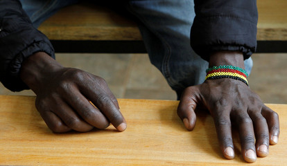Drug addict waits to be served methadone at Medication Assisted Therapy clinic at Karuri Level 4 hospital in Kiambu