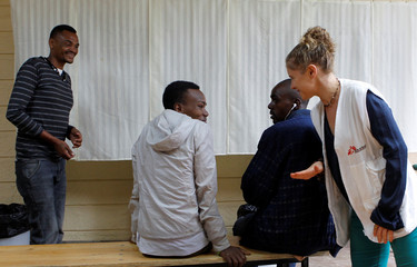 MSF Kenya Programmes-Kiambu project coordinator Jung speaks with recovering drug addicts at Karuri Level 4 hospital in Kiambu