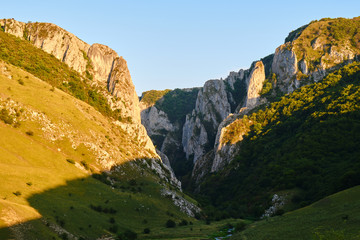 Turda gorge (Cheile Turzii), a location for hiking, climbing, via ferrata in Romania - view of the northern entrance from Petrestii de Jos, at sunset.