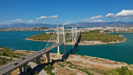 Aerial drone photo of famous new suspension bridge of halkida or Chalkida connecting mainland Greece with Evia island with beautiful clouds and blue sky, Greece