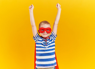 Child as superhero with hands raised