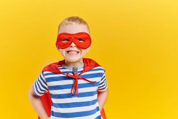 Portrait of boy in superhero costume in studio shot