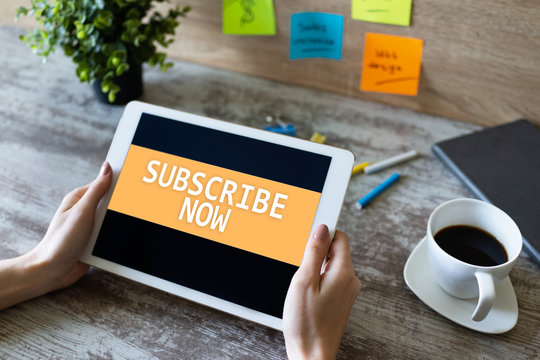 Subscribe button on device screen. Internet and digital marketing concept.