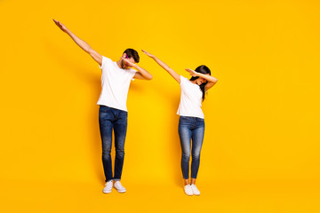 Full body photo of two people dancing at theme party cool modern moves wear casual clothes isolated yellow color background