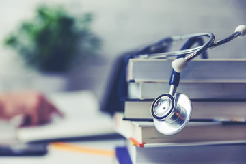 medical college student with stack of books Wall mural