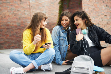 Meeting of three young girls in the city