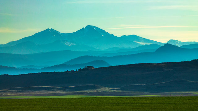 Overlook of mountain range and farmland in afternoon light