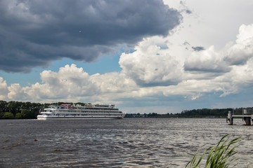 Uglich. Cruise ship on the Volga. Before a storm