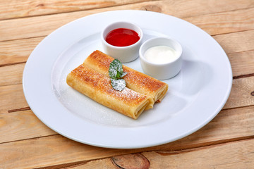 pancakes with sour cream and berry sauce