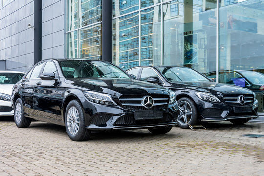 Luxury cars Mercedes-Benz C and E class parkingin a row of car store. Russia. Saint-Petersburg. 09 October 2018.