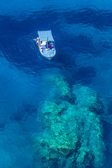 Floating boat in the middle of the sea.