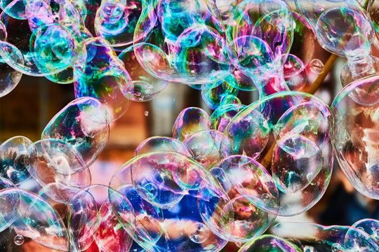 Metallic glowing colorful soap bubble in the air