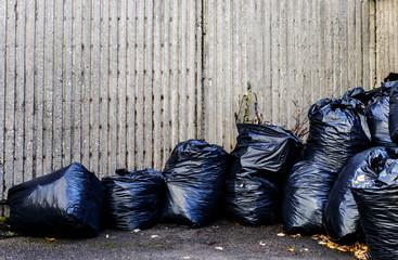 Black plastic rubbish bags.