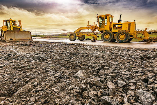 Excavator to level and smooth the land in the construction of a road