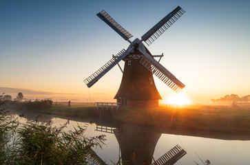 Windmill during a foggy sunrise in the Dutch countryside. Krimstermolen, Zuidwolde.