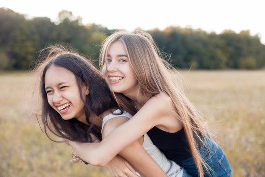 Two young women having fun outdoors. Best friends