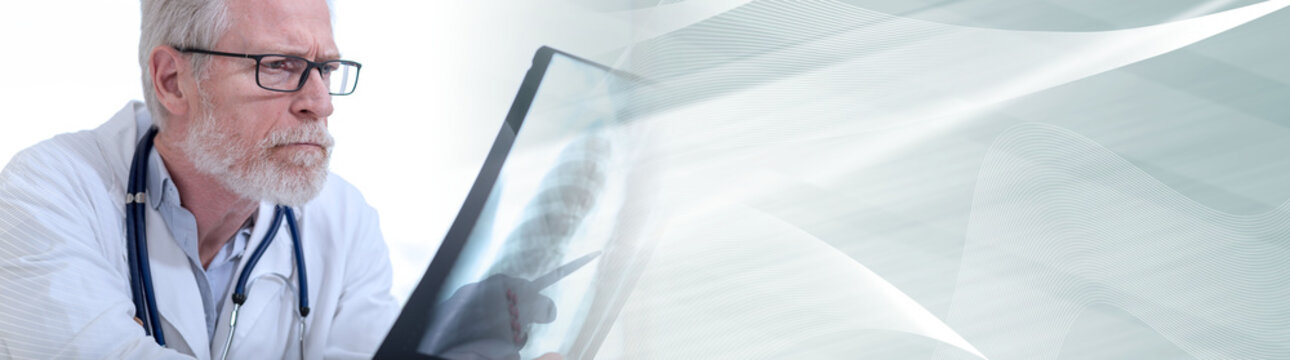 Doctor looking at x-ray; panoramic banner