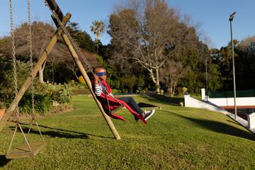 Superhero boy in garden