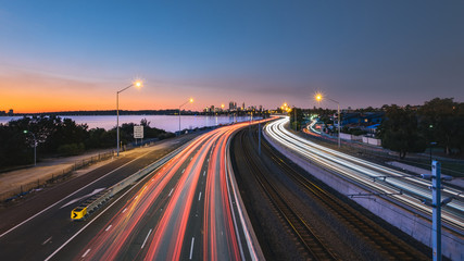 Traffic on city road during sunset in Perth, WA Australia