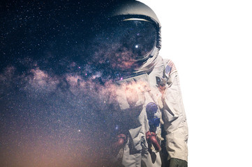 Foto op Plexiglas Nasa The double exposure image of the astronaut's suit overlay with the milky way galaxy image. the concept of imagination, technology, future, and gaming.