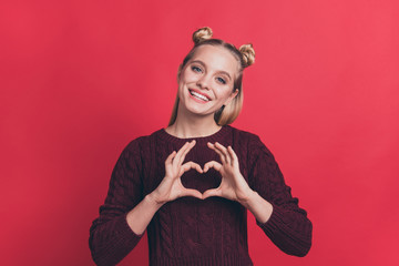 I love you concept. Close up photo portrait of pretty adorable cute dream dreamy girl making showing small hear on her chest wearing maroon color jumper isolated background